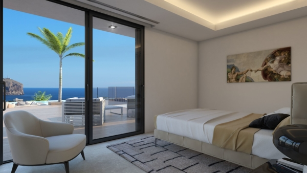 Bed room in modern villas in spain with amazing views of the Mediterranean sea.